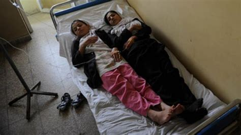 Another mass poisoning in Afghanistan, as women flee