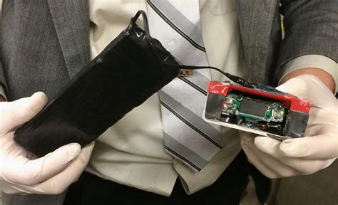Photos show straphangers how to spot a skimming device on