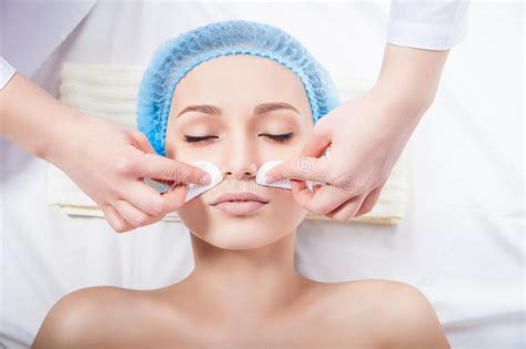 Skin Care - Woman Cleaning Face By Beautician Stock Photo