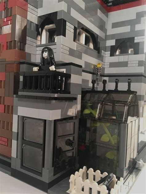 """You Could Help Make This LEGO """"Addams Family"""" Mansion a"""