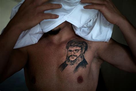 Hezbollah supporters tattoo Nasrallah's face on their chest